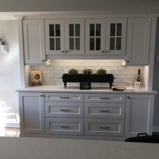 custom white cabinets and storage space