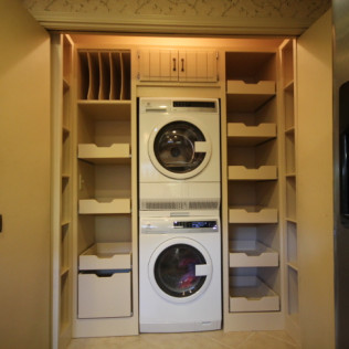 stacked washer and dryer with storage alongside