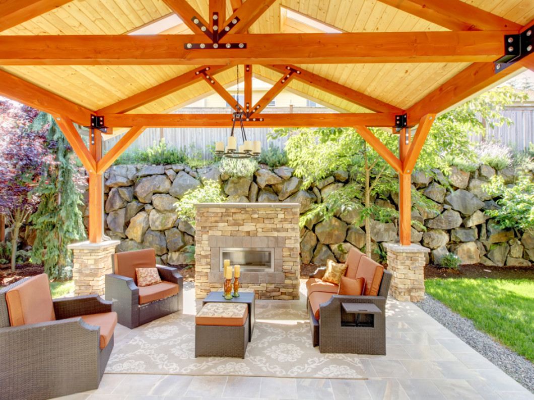 outdoor patio with a fireplace and patio cover